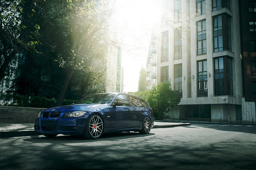 Blue Car Bmw 5 Series E90e91 Stay On Asphalt Road Stock Photo - Download Image Now
