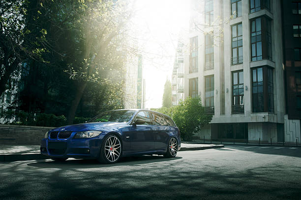 Blue car BMW 5 series E90/E91 stay on asphalt road stock photo