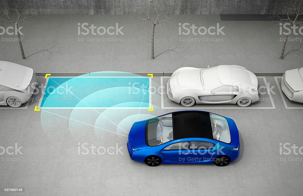 Blue car driving into parking lot with parking assist system stock photo