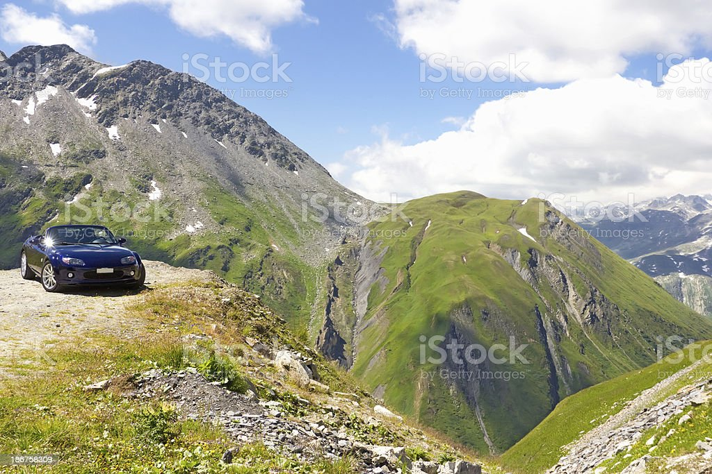 blue Car in the beautiful mountains Alps  - Stock Image royalty-free stock photo