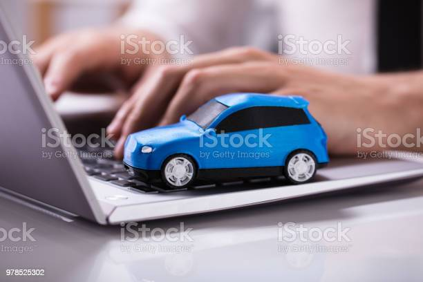 Blue car on laptop keypad picture id978525302?b=1&k=6&m=978525302&s=612x612&h= zclfsxllbkrg7h272ooioxazboph 7i je5beair5e=