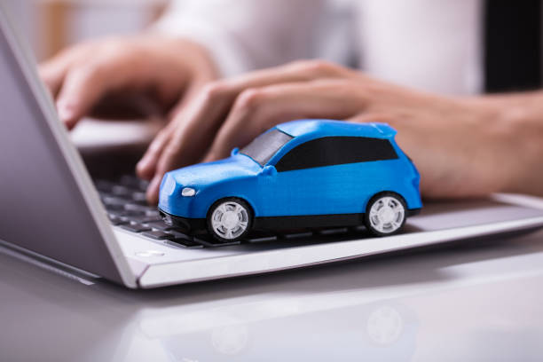 Blue Car On Laptop Keypad Close-up Of A Small Blue Car On Laptop Keypad car stock pictures, royalty-free photos & images