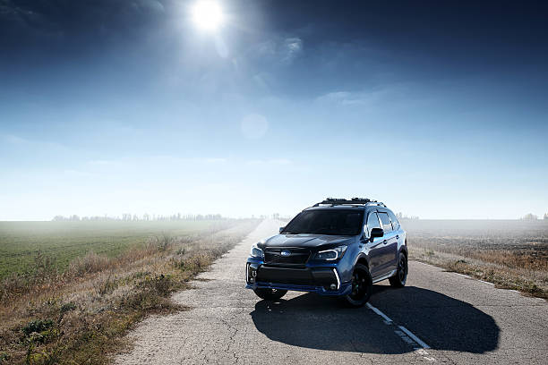 Blue car Subaru Forester standing on asphalt road at daytime Saratov, Russia - October 21, 2015: Subaru Forester car standing at the countryside road at daytime, Russia forester stock pictures, royalty-free photos & images
