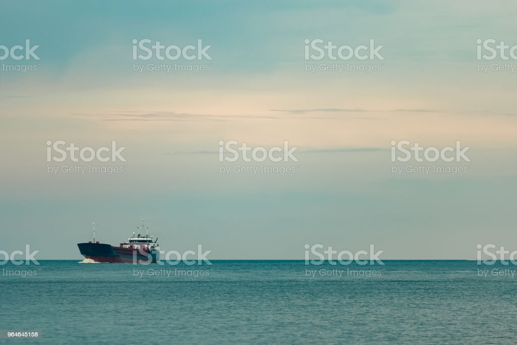 Blue cargo ship underway royalty-free stock photo