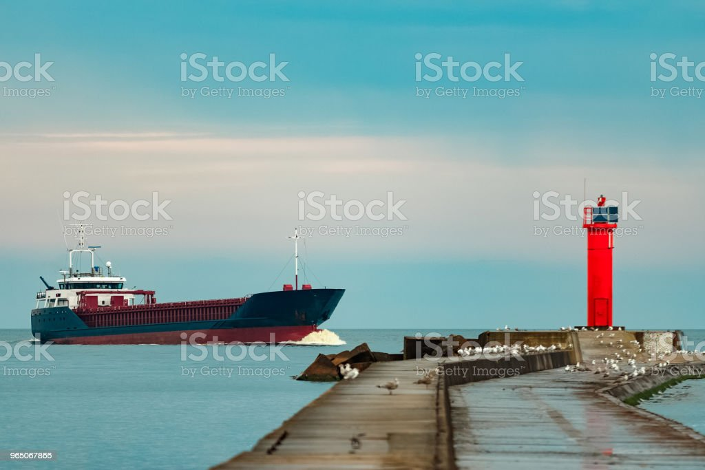 Blue cargo ship underway royalty-free stock photo