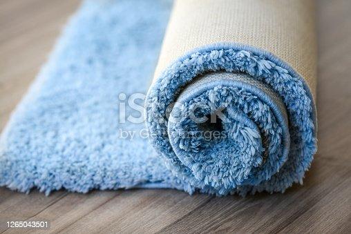 blue carpet roll on the floor