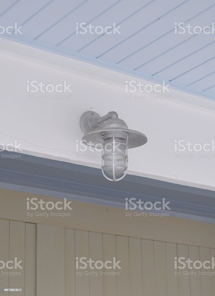 Blue ceiling with light fixture stock photo