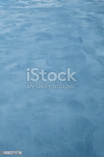 istock Blue cement wall background 1000271716
