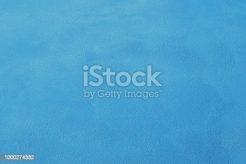istock Blue cement wall background 1000274332
