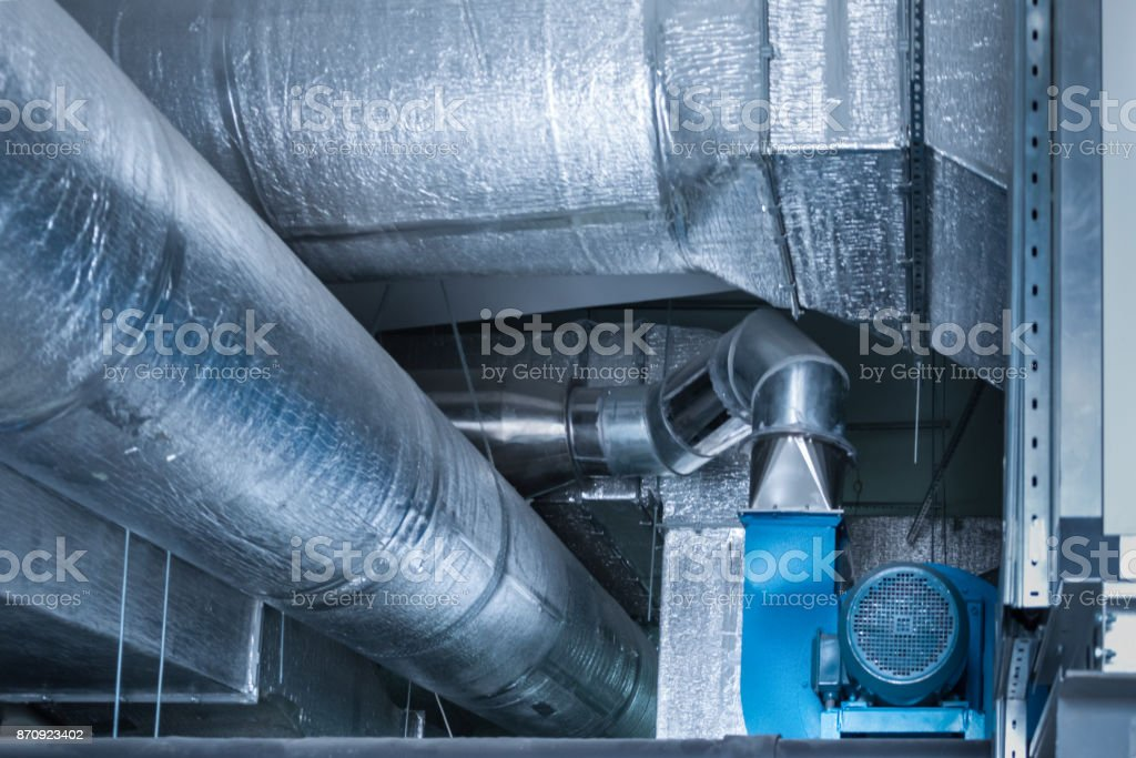 Blue centrifugal fan with huge size industrial ductworks stock photo