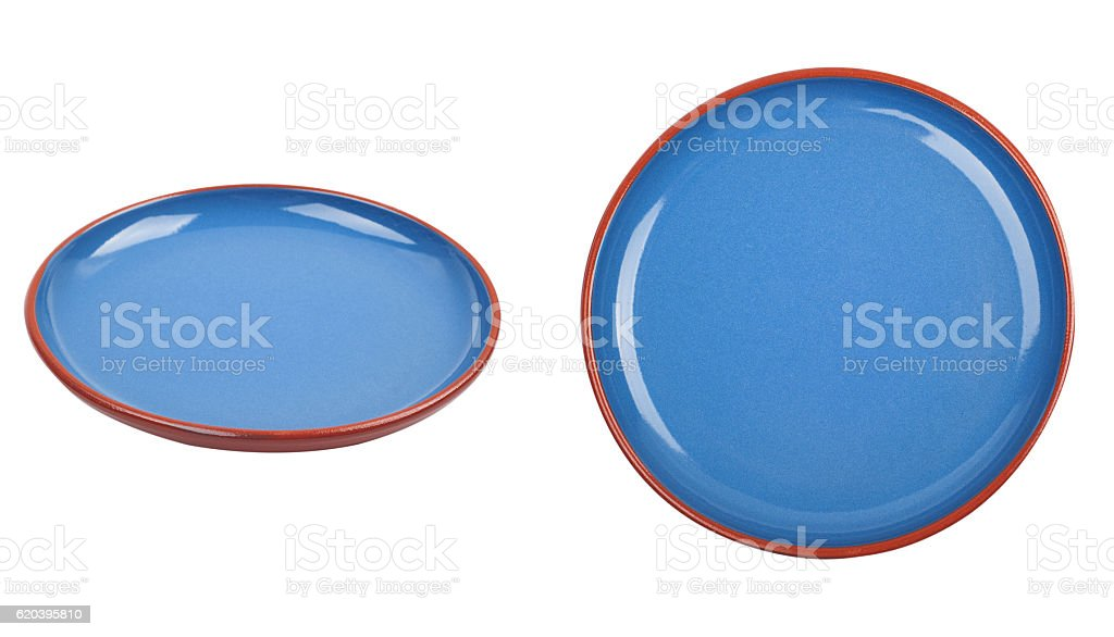 Blue ceramic plate isolated on white background stock photo