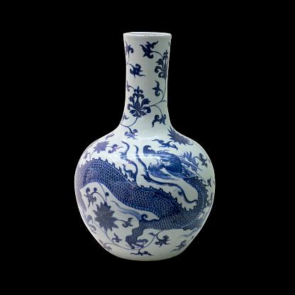blue ceramic porcelain vase on isolated black background
