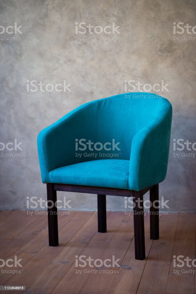 Blue chair against a gray wall. Interior стоковое фото
