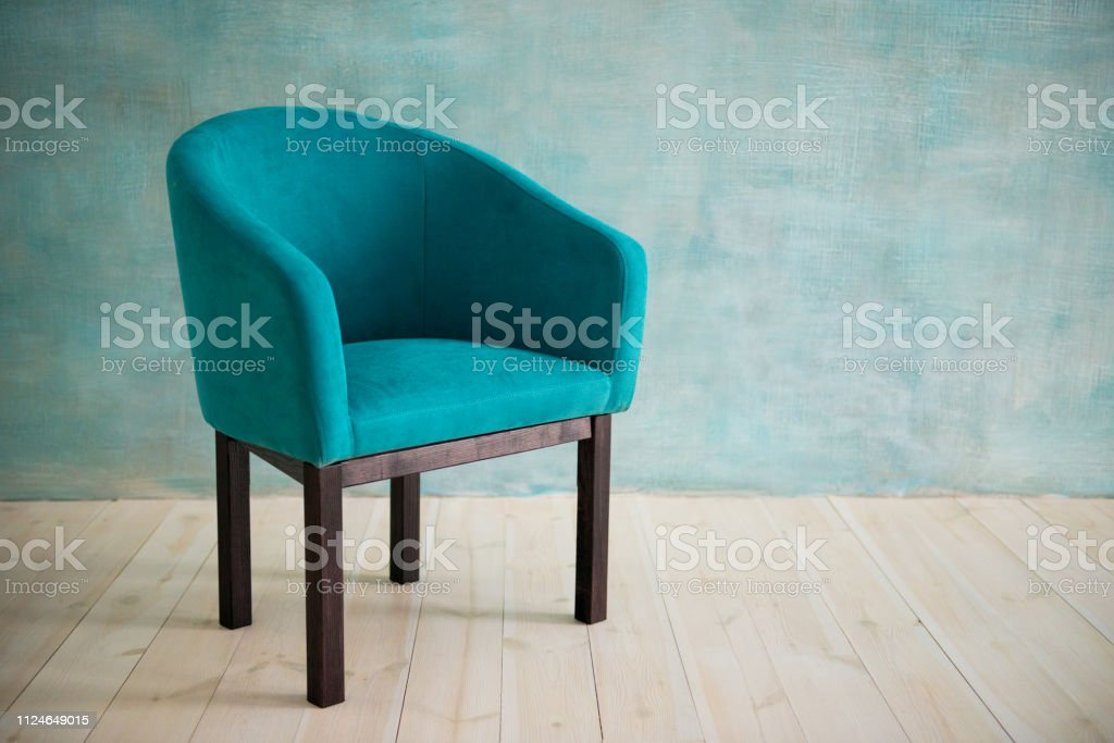 Blue chair against the blue wall. Interior стоковое фото