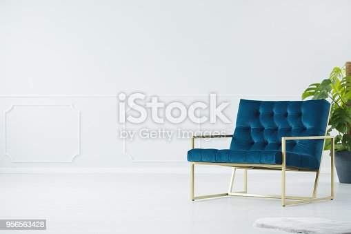 istock Blue chair with golden frame 956563428