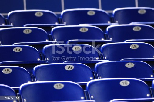171581046istockphoto Blue chairs for stadium seating 179077166