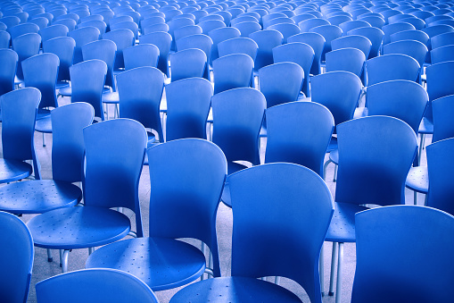 Blue chairs in the meeting room