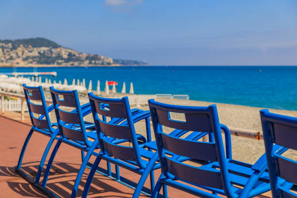 Blue chairs on the Promenade des Anglais in Nice France stock photo