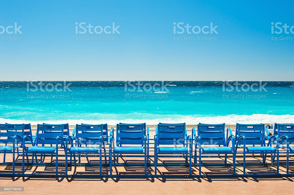 Blue chairs on the Promenade des Anglais in Nice, France stock photo