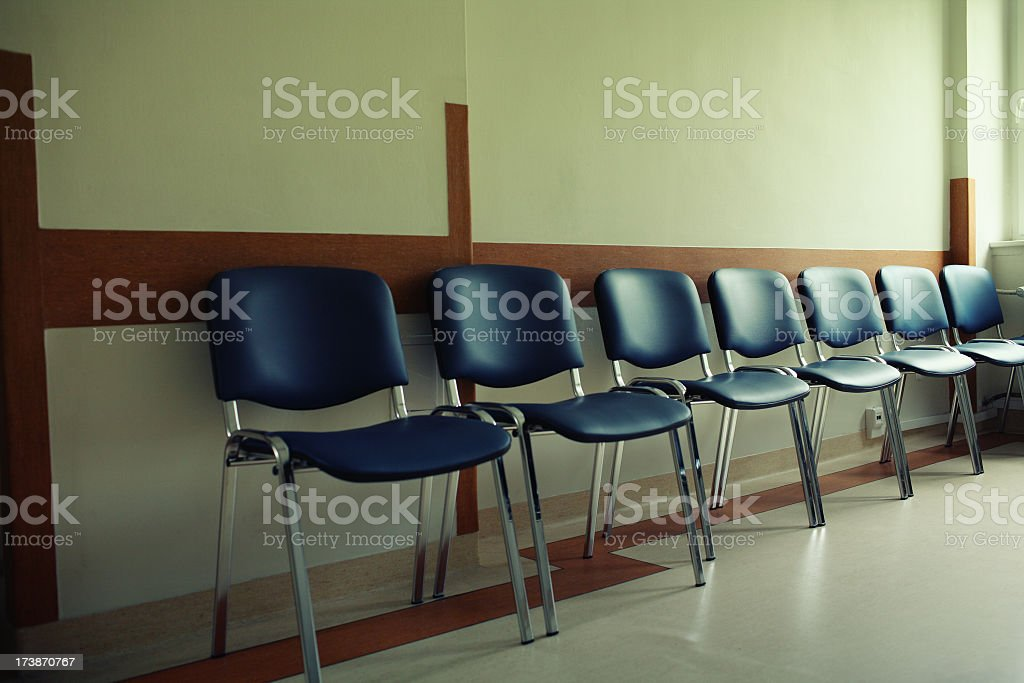 Blue chairs outside the waiting room royalty-free stock photo