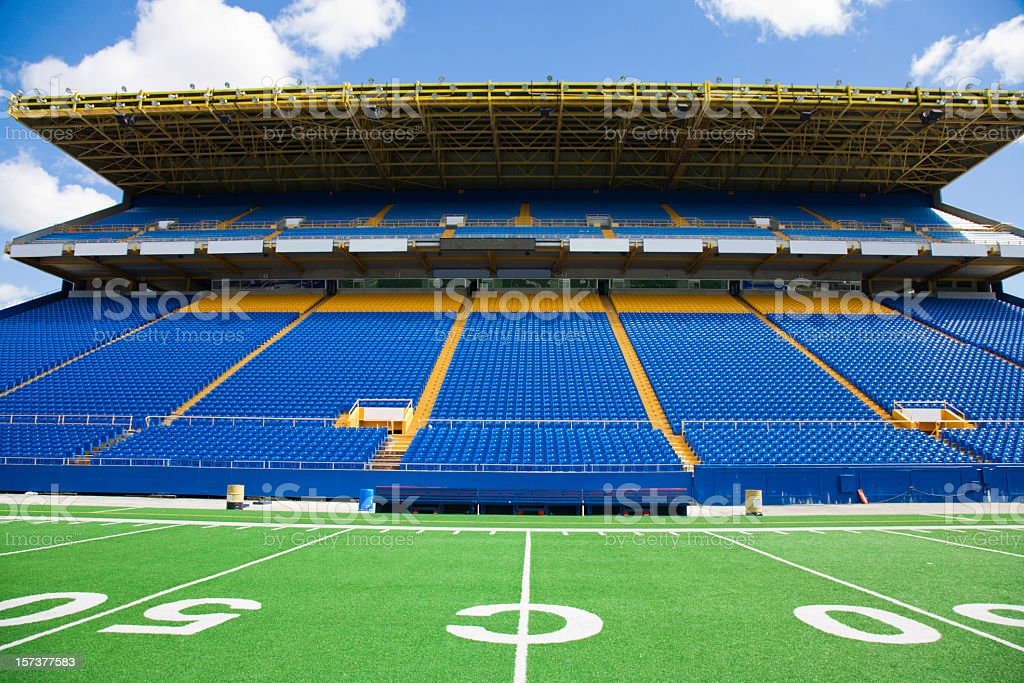Blue chairs with no audience at a football stadium royalty-free stock photo