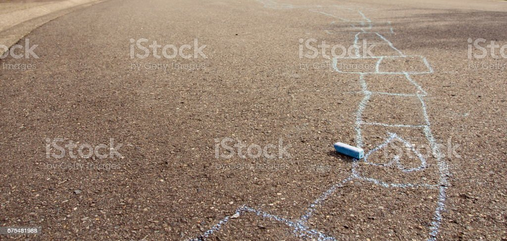 Blue chalk drawing on asphalt surface in Seattle suburb stock photo