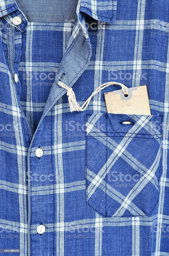 Blue checked shirt with price tag royalty-free stock photo