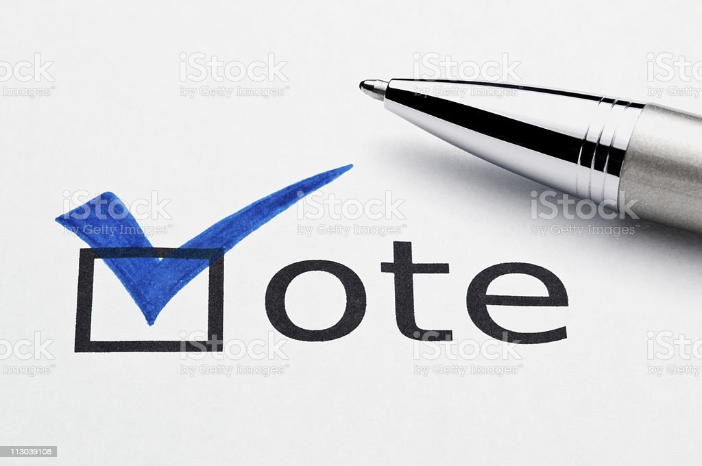 Blue checkmark in vote checkbox, pen lying on ballot paper royalty-free stock photo