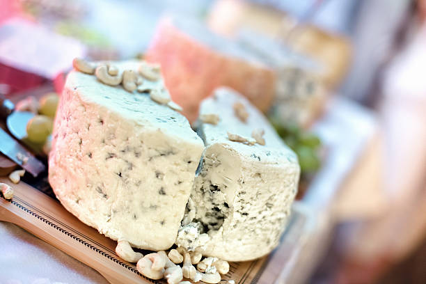 blue cheese close-up as appetiser with various types of cheese - appetiser stock photos and pictures