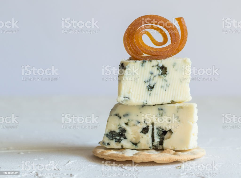 Blue cheese on cracker with candied peach roll decoration royalty-free stock photo
