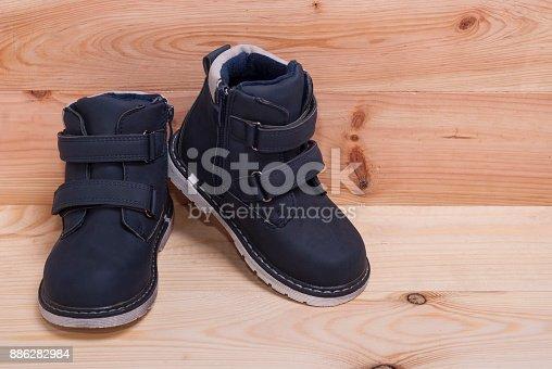istock blue children's boots 886282984