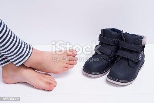 istock blue children's boots 886283004