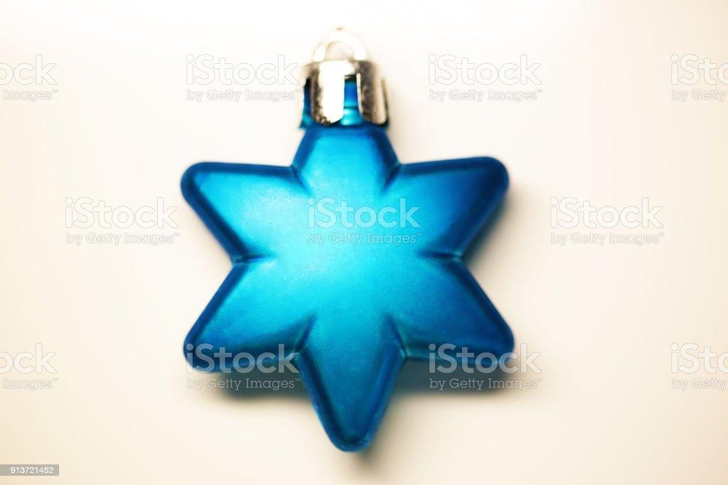 Blue chrismas ornament of star shape stock photo