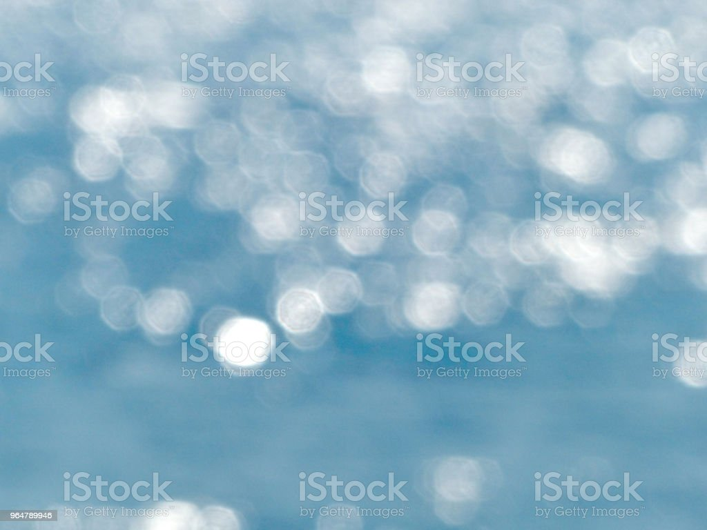 blue christmas background with bokeh lights royalty-free stock photo