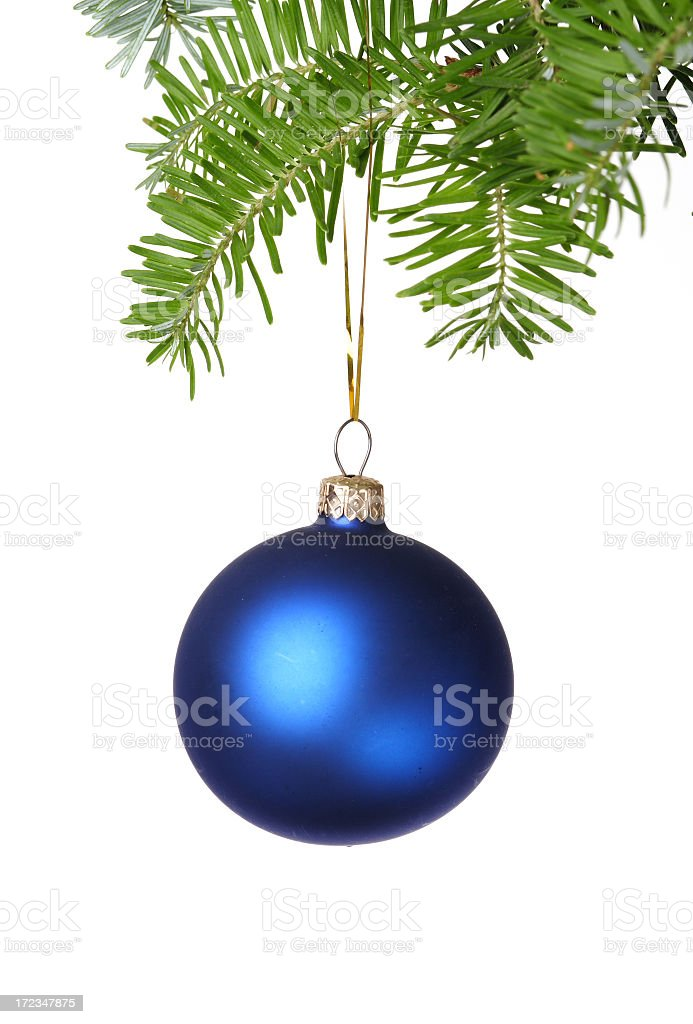Blue Christmas ball hanging from a Christmas tree branch royalty-free stock photo