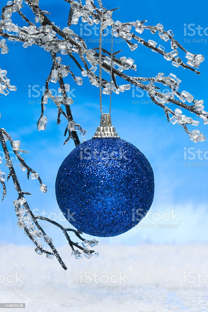 blue Christmas ball on winter tree royalty-free stock photo