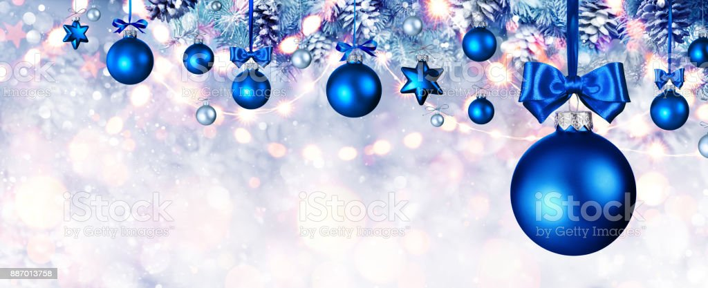 Blue Christmas Balls Hanging At Fir Branches stock photo
