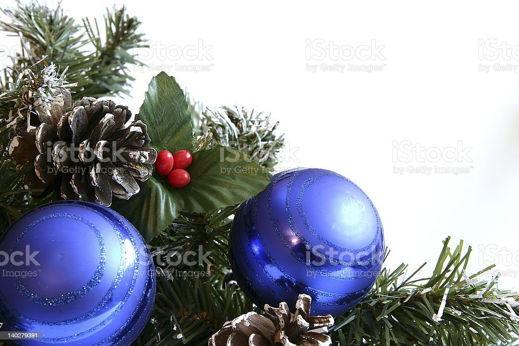 Blue Christmas balls in holly branch royalty-free stock photo