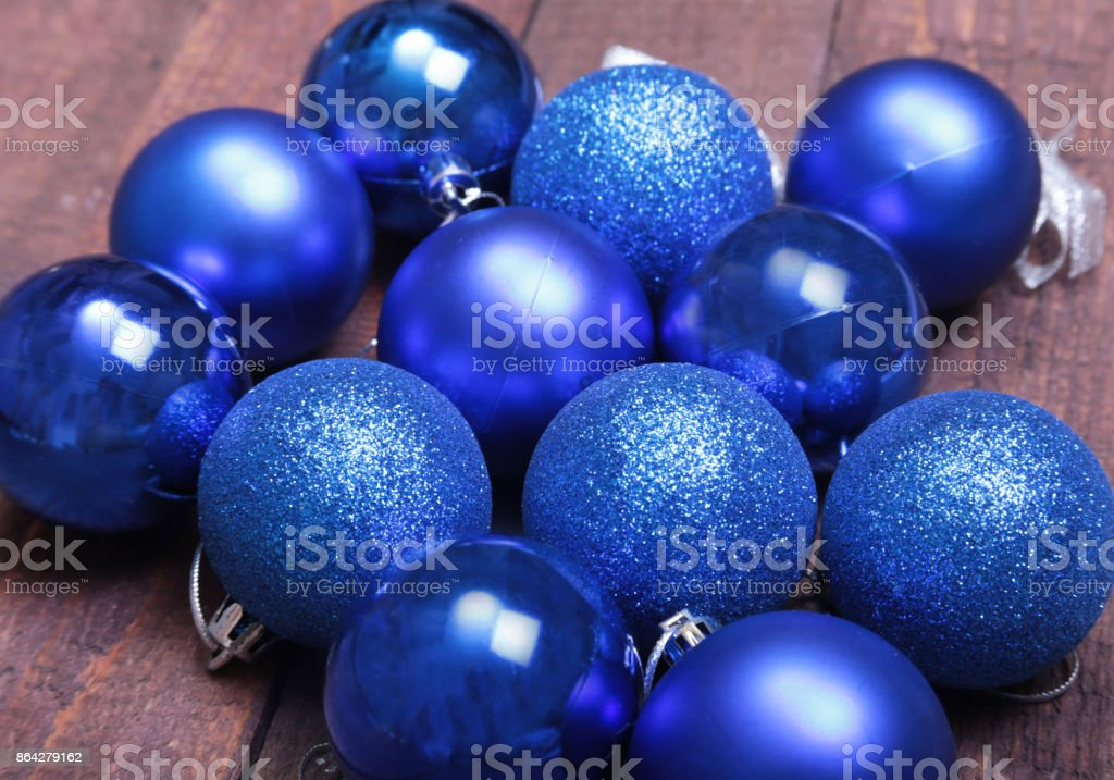 Blue christmas balls on a wooden background royalty-free stock photo