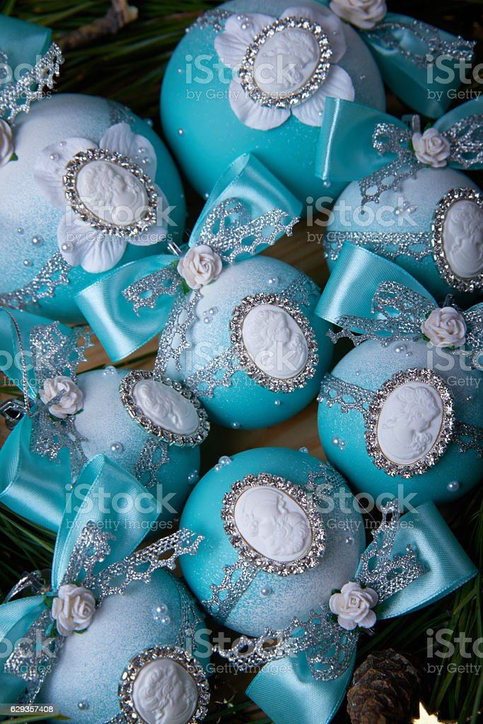 Blue Christmas balls with a cameo on spruce branches stock photo