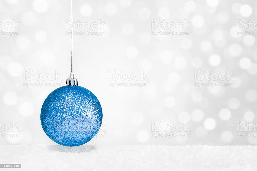 Blue Christmas Bauble on Defocused Background. stock photo