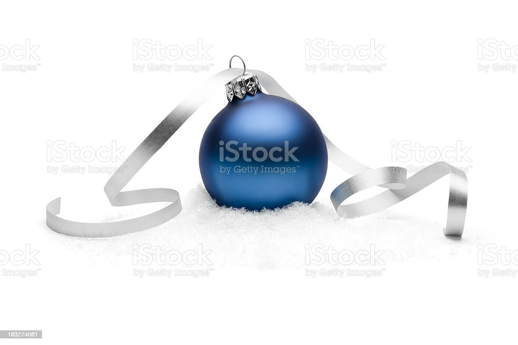 Blue christmas bauble on snow stock photo