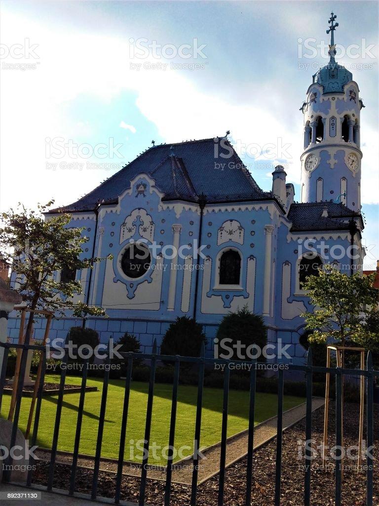 Blue church of Bratislava behind fence stock photo