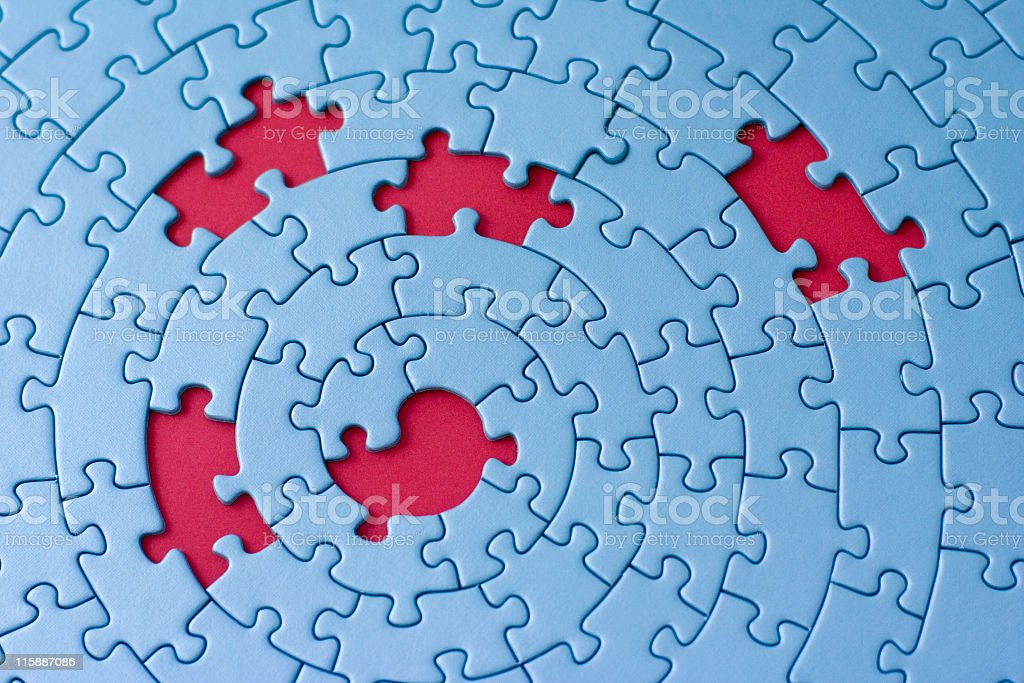 A blue circular puzzle with 5 pieces missing showing red royalty-free stock photo