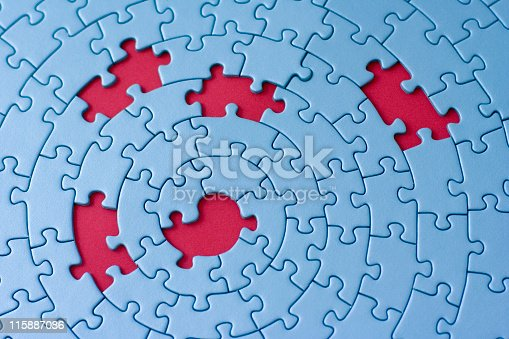 istock A blue circular puzzle with 5 pieces missing showing red 115887086