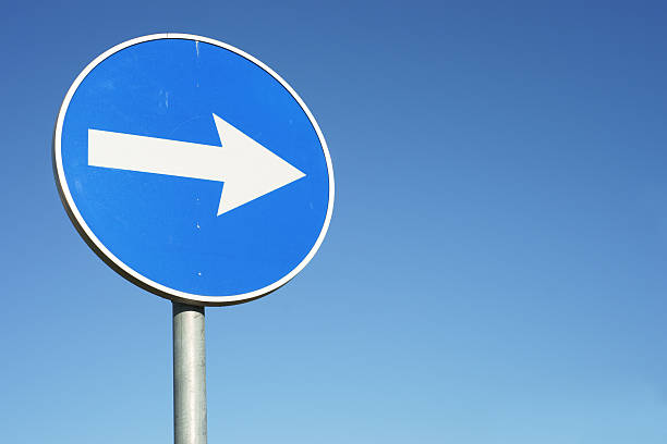 blue, circular right turn traffic sign - road signs stock pictures, royalty-free photos & images