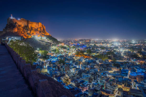Blue city and Mehrangarh fort on the hill at night in Jodhpur, Rajasthan, India stock photo