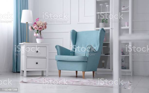 Blue classic armchair with table lamp and flower vase on drawer picture id1152497259?b=1&k=6&m=1152497259&s=612x612&h=el2wuowpw f7vcd0pzdqf8cl71g3rc2orwkgonavtvy=