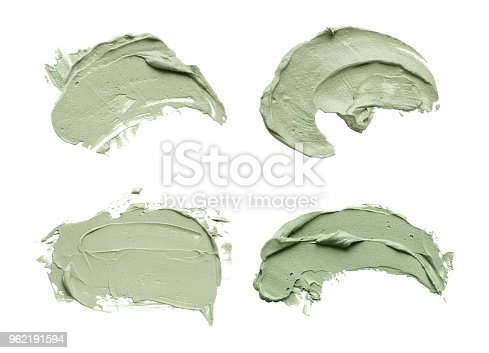 istock Blue clay facial mask smear on white isolated background 962191594
