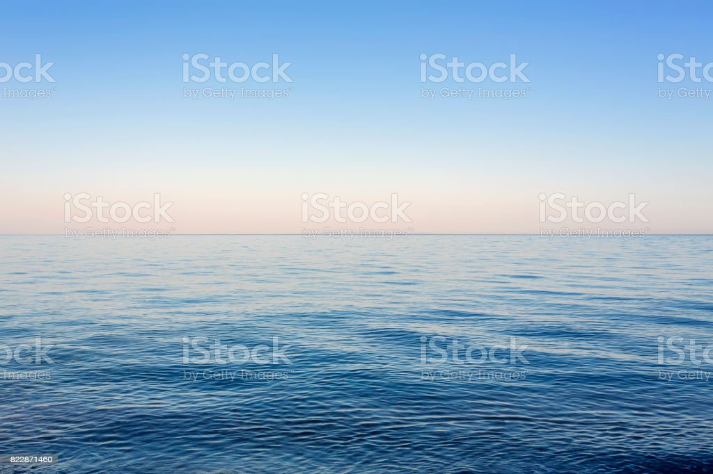 Blue clear sky above the calm Ionian Sea at sunset in Kefalonia stock photo